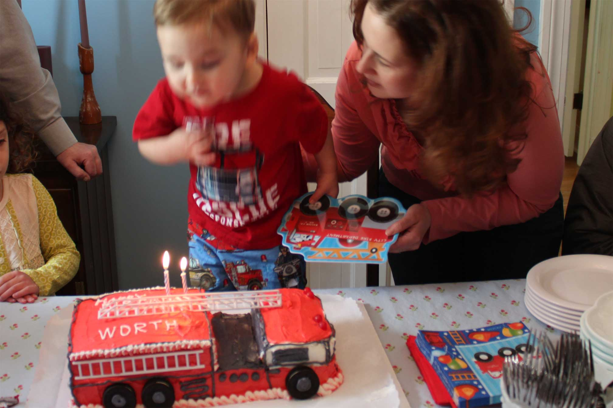 My Mom Made Worths Birthday Cake In The Shape Of A Fire Truck Which He Identifies By Sound It Makes Awoooooooo I Little Gift Bags For